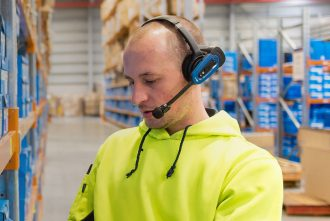 Man wearing Honeywell Vocollect Voicelink technology