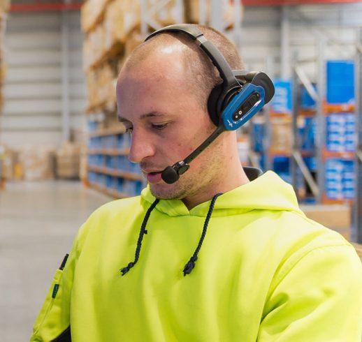 Man wearing Honeywell Vocollect Voicelink technology